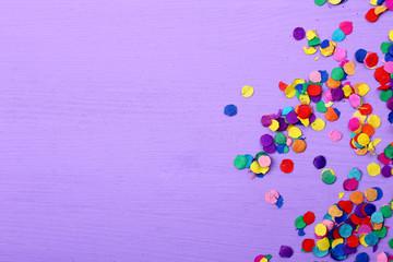 colorful confetti on purple background