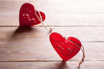 Red hearts on wooden background. Symbol of love in valentine's day.