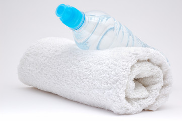 Bottle of water and towel