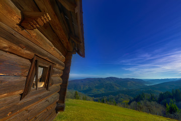 wooden hut on the mountain hills