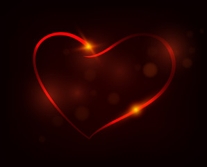 Glowing heart on a dark background