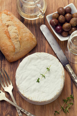 cheese with bread, olives and white wine