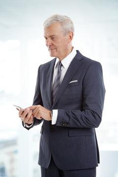 Senior businessman with mobile phone