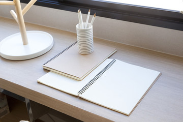 note book by the window