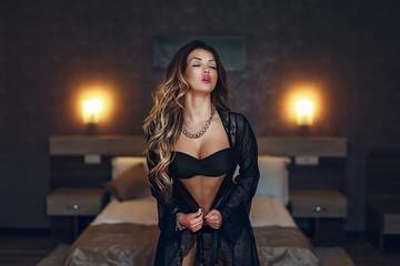 Boudoir photo of sexy girl wearing stylish black lingerie underwear
