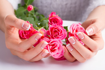 Wall Mural - Beautiful gentle french manicure.