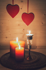 Romantic arrangement with hearts and candles