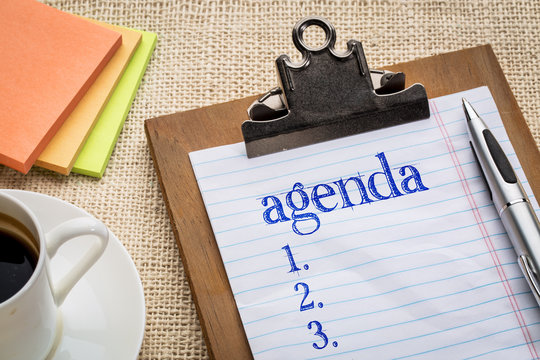 agenda list on clipboard and coffee