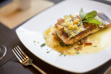 Grilled salmon with sauce and herbs