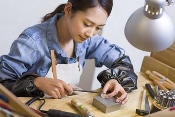 Female jeweler making a ring