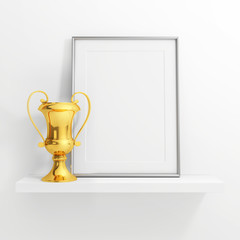 gold cup and blank photo frame on white shelf on white backgroun