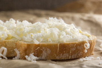 Bread with butter and grated cheese