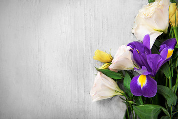 Beautiful bouquet of flowers on white  wooden background, copy space