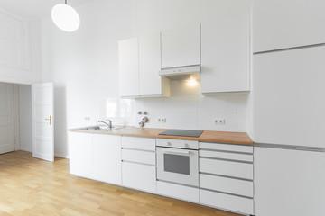 white kitchen / built-in kitchen , wooden floor