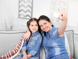 Mother and daughter making selfie