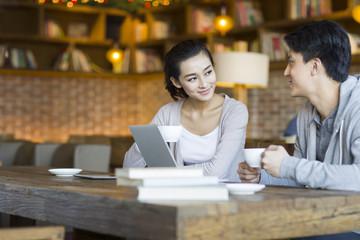 Couple having coffee in cafÈ