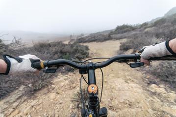 Woman making downhill with mountain bike.