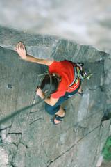 Climber girl on rock