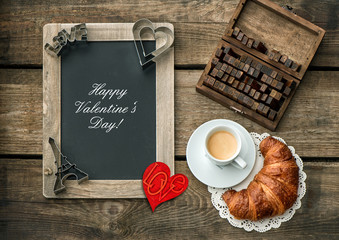 Coffee with croissant. Red heart decoration. Valentines Day