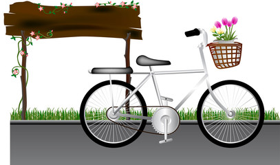 Bicycle art design in road and flower in basket front