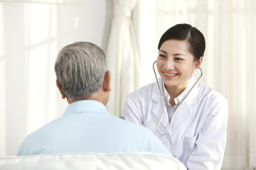 Family doctor examing senior patient