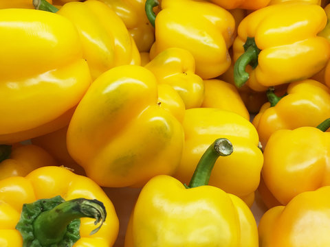 organic yellow bell peppers in market place