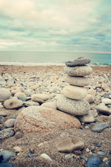 Stacked stones on the beach. Summer, vacation, travel, spa, relaxation, nautical and life style concept