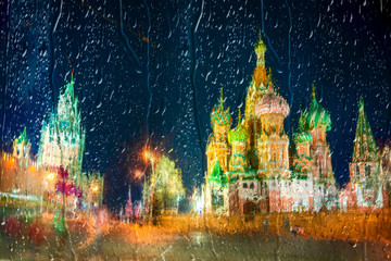 Fototapete - Moscow,Russia,Red square,view of St. Basil's Cathedral at rainy night, through wet window