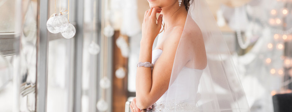 valentine's day, bridal, wedding, christmas, x-mas, winter, happiness concept - bride looking at window.