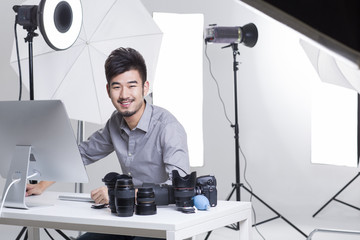 Portrait of smiling photographer working in studio
