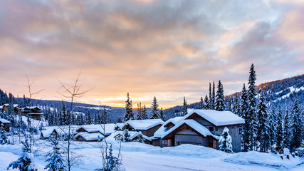 Wall Mural - Sunrise over the Ski Resort village of Sun Peaks in the Shuswap Highlands in central British Columbia, Canada