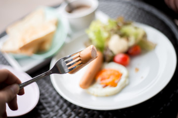 Breakfast dish close up at sausage