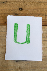 Letter  of the alphabet written with crayon timber