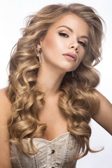 Beautiful blonde in a wedding image with curls, light lips. Beauty face.