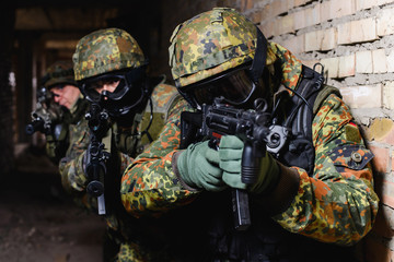 Team of Special Forces from Germany with weapon/Group of elite police marksmen with weapon in building during a special operation