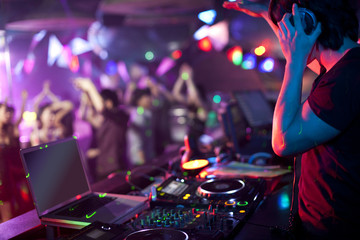 DJ doing record Scratching in nightclub