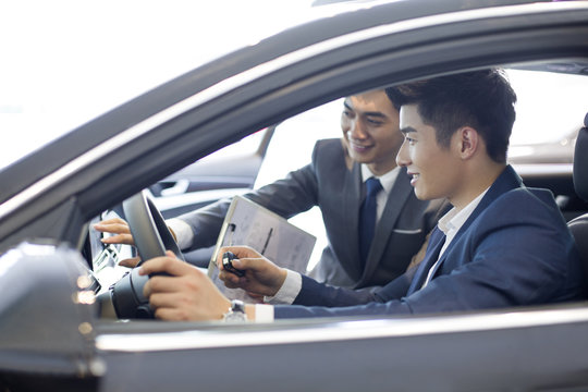 Young businessman taking a test drive