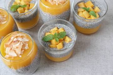 Homemade Chia seed pudding with mango, selective focus, toning
