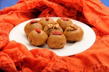 Besan laddu, handmade vegan sweets with wallnuts and goji berrie
