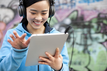 Woman listening to music with digital tablet