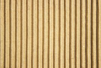 Cardboard paper background bright vertical corrugated strips