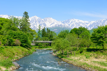 Shirouma mountains and Himekawa river at Ooide park in Hakuba, Nagano, Japan
