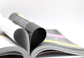 Pages of a book curved into a heart shape, love concept