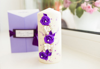white wedding candles with bright beautiful flowers