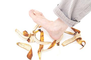 Man foot stepping on banana peel