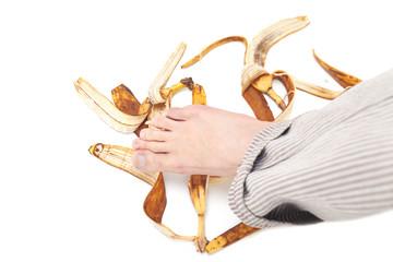 Men foot on banana peel