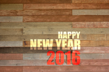Happy New Year 2016 word on vintage wood wall background