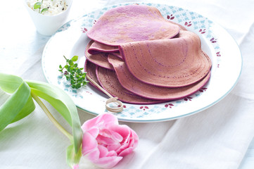 Red beet crepes stuffed with ricotta
