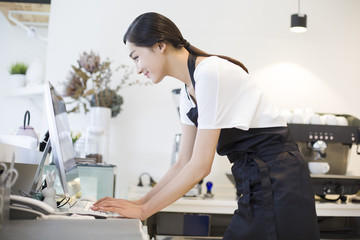 Coffee shop owner using computer