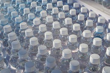 Batch of plastic bottles of water.